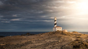 Lighthouse. Beautiful and mysterious lighthouse in a cloudy day Stock Images