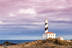 Lighthouse. Beautiful and mysterious lighthouse in a cloudy day Royalty Free Stock Image