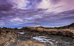 Lighthouse. Beautiful and mysterious lighthouse in a cloudy day Royalty Free Stock Images