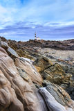 Lighthouse. Beautiful and mysterious lighthouse in a cloudy day Royalty Free Stock Photography