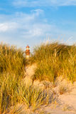Lighthouse behind sand hill Royalty Free Stock Photography