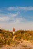 Lighthouse behind sand hill Stock Photos