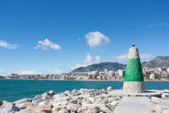 A lighthouse of Benalmadena and a view to Mediterranean sea and coast. With hotels and mountains, Andalusia, Spain Royalty Free Stock Photo