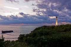 Lighthouse Biarritz, sunset and clouds, thunderstorm stock photography