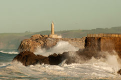 Lighthouse in the big waves, storm in Mouro, Santander Stock Photos