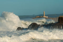 Lighthouse in the big waves, storm in Mouro, Santander. Spain stock photo