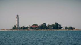 Lighthouse on Biryuchyi Island, Ukraine stock video footage
