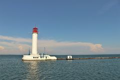 Odessa, Ukraine. Lighthouse located next to the harbour. Lighthouse in the Black sea. Touristic landmark, view from a boat royalty free stock photo