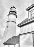 Lighthouse Black & White. Black and white lighthouse with cloudy sky Royalty Free Stock Photos