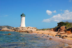 Lighthouse in blu sea Royalty Free Stock Image