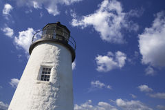 Lighthouse in the blue cloudy sky Royalty Free Stock Photo
