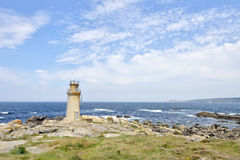 Lighthouse with blue ocean Royalty Free Stock Image