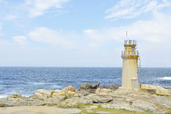 Lighthouse with blue ocean Stock Image