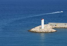 Lighthouse in the blue sea Stock Photography