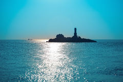 Lighthouse in blue sea Royalty Free Stock Images