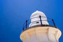 Lighthouse in Blue Skies Background Stock Images