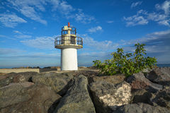 Lighthouse on blue sky background Royalty Free Stock Photos