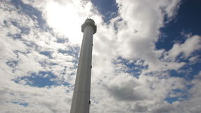 Lighthouse with blue sky,clouds.Malapascua Island. Lighthouse on a tropical island,blue sky,clouds.Beautiful landscape view of Lighthouse located at Malapascua stock footage