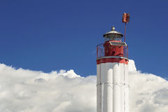 Lighthouse, blue sky, white clouds.  Stock Photo