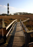 Lighthouse and Board Walk Bridge. Bodie Island Light House, Outher Banks, North Carolina.  A view from a bridge at the marsland board walk, late afthernoon Royalty Free Stock Images