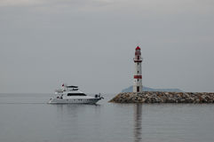 Lighthouse and boat. Lighthouse and boat in Turgutreis Turkey royalty free stock photo