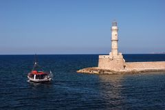 Lighthouse and a boat Stock Photography