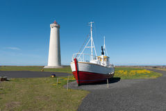 Lighthouse and boat in Iceland. Lighthouse and boat on the Reykjanes peninsula in Reykjavik, Iceland Stock Image