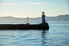Lighthouse and a boat. In the marine Stock Photography