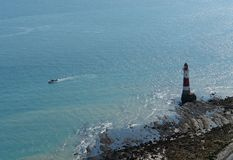 Lighthouse and Boat near Beachy Head Royalty Free Stock Photo