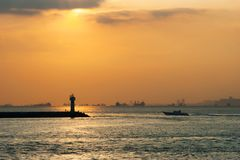 Lighthouse and boat silhouette with sunset on steamboat in Ä°stanbul stock image