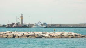 Lighthouse and boats. stock footage