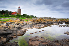 Lighthouse on Bornholm island. Lighthouse and rocks on Bornholm island stock photo
