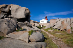 Lighthouse among the boulders on Lavezzi island, Corsica, France Royalty Free Stock Image