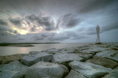 Lighthouse. A Lighthouse on a breaker at the river mouth Royalty Free Stock Photography