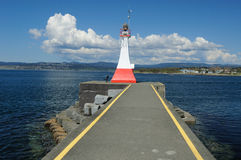 Lighthouse and breakwater Royalty Free Stock Photo