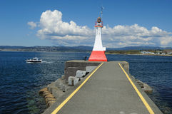Lighthouse and breakwater Stock Images