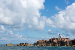 Lighthouse of Brehat island in Brittany. Lighthouse on the Rocky North Coast of the island of Brehat, Brittany, France royalty free stock photo