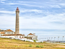 Lighthouse with bright blue sky background. Royalty Free Stock Images