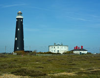 Lighthouse and buildings at Dungeness. UK Royalty Free Stock Images