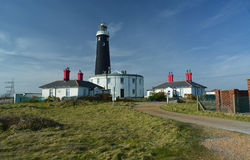 Lighthouse and buildings at Dungeness. UK Stock Photos