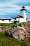 Lighthouse Built on Rocky Terrain Stock Image