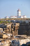 Lighthouse on Cabo Carvoeiro  with rocks on foreground, Peniche Stock Images