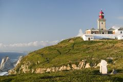 The lighthouse on Cabo da Roca on the Atlantic Ocean in Sintra, Portugal, the westernmost point on the continent of Europe, which  Stock Image