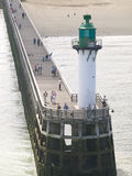 Lighthouse at Calais France. View from the Calais lighthouse with people fishing and walking around.Situated at the north of France in the La Manche Channel Royalty Free Stock Photo
