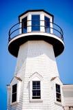 Lighthouse. Cap cod lighthouse on the beach with blue sky Royalty Free Stock Photo