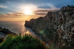 Lighthouse at Cap de Formentor in Mallorca at the sunrise. Lighthouse and cliff rock at Cap de Formentor in Mallorca at the sunrise, Majorca, Balearic islands Royalty Free Stock Photos