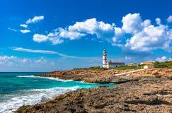 Lighthouse of Cap de Ses Salines on Majorca Spain. Beautiful view of the lighthouse of Cap de Ses Salines on Mallorca island, Spain Mediterranean Sea, Majorca Stock Images