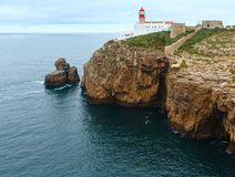 Lighthouse on cape, Algarve, Portugal. Stock Images