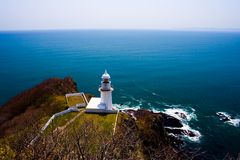 Lighthouse at Cape Chikyu (Cape Earth), Muroran, Hokkaido, Japan. Royalty Free Stock Images