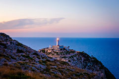Lighthouse at Cape Formentor in the Coast of North Mallorca, Spain  Balearic Islands . Artistic sunrise and dusk landascape Royalty Free Stock Photo